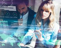 Concept of digital diagram,graph interfaces,virtual screen,connections icon on blurred background.Group of two young Royalty Free Stock Photography