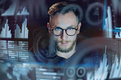 Concept of digital diagram,graph interfaces,virtual screen,connections icon.Portrait of young businessman working modern Stock Photos
