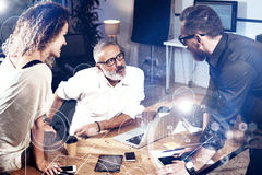 Concept of digital screen ,virtual connection icon,diagram, graph interfaces.Bearded man talking with sales director and. Concept of digital screen ,virtual Stock Image
