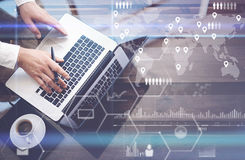Concept of digital screen,virtual connection icon,diagram,graph interfaces.Businessman working with laptop at office Stock Photography