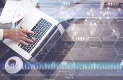 Concept of digital screen,virtual connection icon,diagram,graph interfaces.Man working with laptop at office.Modern Stock Photos