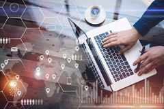 Concept of digital screen,virtual connection icon,diagram,graph interfaces.Man working with laptop at office at wooden Stock Photos