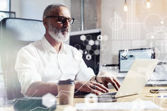 Concept of digital screen,virtual icon,diagram, graph and interfaces.Middle age account manager wearing a classic Royalty Free Stock Photo