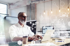 Concept of digital screen,virtual icon,diagram, graph and interfaces.Middle age financial analyst wearing a classic Royalty Free Stock Photos