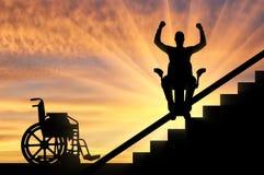 Concept disabled lift, elevator, handicap. Happy disabled person climbs on elevator for disabled on stairs. Concept disabled lift, elevator, handicap Stock Images