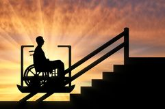 Concept disabled lift, elevator, handicap. Disabled person climbs on elevator for disabled on stairs. Concept disabled lift, elevator, handicap Stock Photography