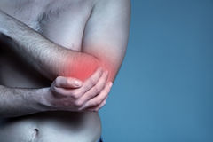 Concept disease. Pain in elbow joint Stock Photos