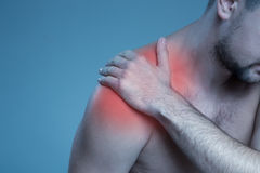 Concept disease. Pain in the shoulder joint Stock Photos