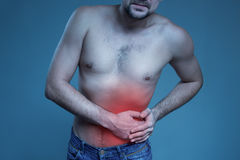 Concept disease. Pain in stomach Royalty Free Stock Images