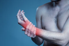 Concept disease. Pain in wrist Royalty Free Stock Photos