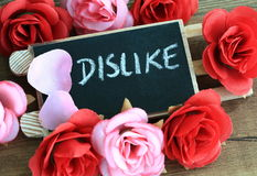 Concept of dislike. With flowers in background Royalty Free Stock Images