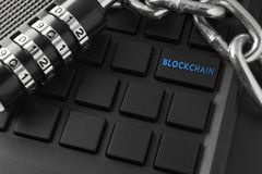 Concept of distribution network technology blockchain. Lock, chain keyboard. characters on remote keys. Blockchain enter key. Concept of distribution network stock photo