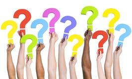 Concept divers de question de FAQ de la Communauté de mains Images stock
