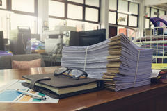 Concept of document workload, Pile of unfinished documents on office desk, Stack of business paper Royalty Free Stock Image