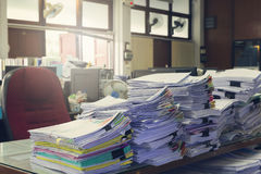 Concept of document workload, Pile of unfinished documents on office desk, Stack of business paper Stock Photography