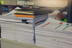 Concept of document workload, Pile of unfinished documents on office desk, Stack of business paper Royalty Free Stock Photo