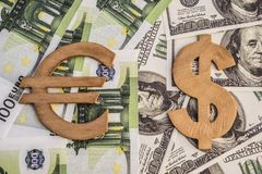 Concept of dollar and euro symbols. On money banknotes close-up Royalty Free Stock Photo
