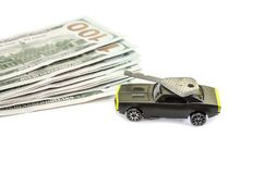 Concept with dollars, toy car and key isolated on white background stock photography