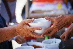 Concept of donation feeding the poor to help each other in society.  Stock Images