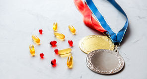 Concept of doping in sport - deprivation medals Royalty Free Stock Photo