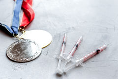 Concept of doping in sport - deprivation medals Royalty Free Stock Image