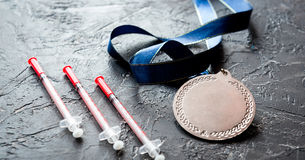Concept of doping in sport - deprivation medals Royalty Free Stock Photography