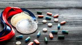 Concept of doping in sport - deprivation medals Royalty Free Stock Images