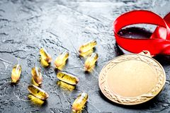 Concept of doping in sport - deprivation medals. Close up on dark background stock image