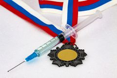 Doping with Russian athletes. Concept of doping in sport - deprivation medals Stock Photos