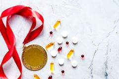 Concept of doping in sport - deprivation medals top view.  stock photos