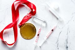 Concept of doping in sport - deprivation medals top view.  stock image