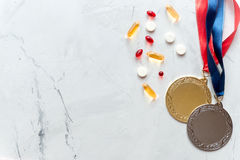 Concept of doping in sport - deprivation medals top view Stock Images
