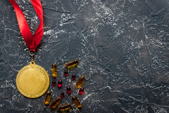 Concept of doping in sport - deprivation medals top view Royalty Free Stock Image