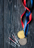 Concept of doping in sport - deprivation medals top view Royalty Free Stock Images
