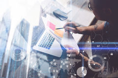 Concept of Double exposure.Adult tattooed coworker working with laptop at workplace.Businessman analyze documents on stock image