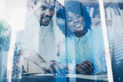 Concept of double exposure.Two young coworkers working together in a modern office.Black business partners discussing royalty free stock photography