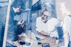 Concept of double exposure.Young team business people making great work discussion in modern studio.Bearded man talking Royalty Free Stock Photo
