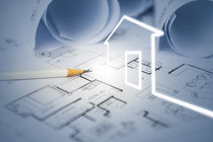 Concept of dream house draw by designer with construction drawin Royalty Free Stock Photo