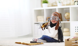 Concept of dreams and travels.  pilot aviator child with a toy a Royalty Free Stock Photo