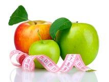 Concept du régime, pommes avec la bande de mesure Images libres de droits