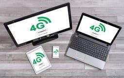concept du réseau 4g sur différents dispositifs Photographie stock libre de droits