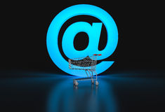 Concept of e-commerce. Big @ sign and empty shopping cart on bla. Ck background. 3d render Stock Photo