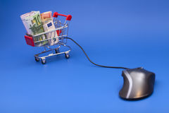 Concept of e-shopping.Shopping cart with euro and computer mouse Stock Photography
