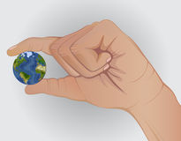 Concept. Earth in hand. Keep fingers Royalty Free Stock Photography