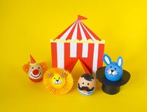 The concept of Easter with cute and cheerful handmade eggs. A rabbit, a clown, a strongman and a lion.Circus Yellow background. Funny egg. Painted Easter eggs Royalty Free Stock Photos