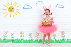 Concept easter. Happy girl in costume bunny rabbit with basket o Stock Photo