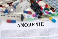 Anorexia concept written in French with drugs. Concept of eating disorders with drugs stock image