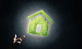 Concept of eco architecture presented by green house on dark bac Royalty Free Stock Image