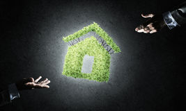 Concept of eco architecture presented by green house on dark bac Royalty Free Stock Photos