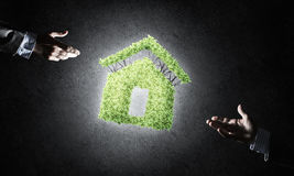 Concept of eco architecture presented by green house on dark bac Stock Photography